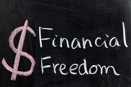 Chalk drawing - Financial freedom words written on chalkboard Stock Photo - 12701695