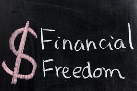 Chalk drawing - Financial freedom words written on chalkboard Stock Photo - 12701695