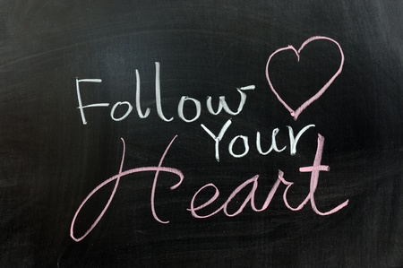 Conceptional chalk drawing - Follow your heart photo