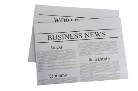 Business news newspaper isolated on white photo