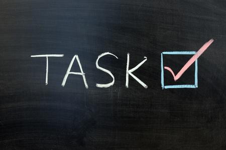 Chalk writing - Task accomplished concept Stock Photo - 12907391
