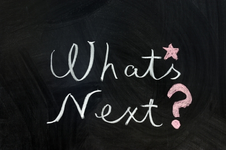 the next step: Chalk writing - Whats next words written on chalkboard Stock Photo