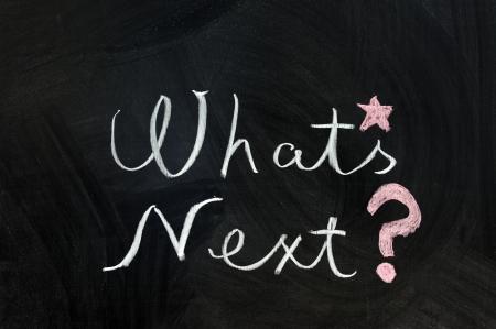 Chalk writing - Whats next words written on chalkboard Stock Photo