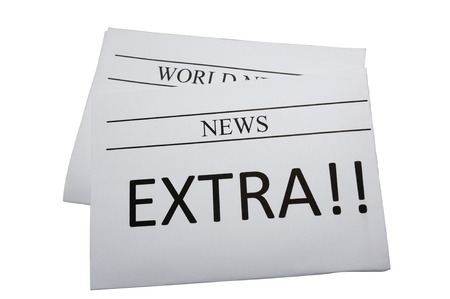 Newspaper with extra news isolated on white photo