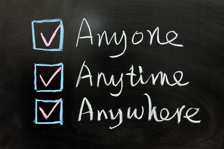 Check box of Anyone, Anytime and Anywhere on chalkboard