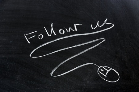 Follow us and mouse drawn on the chalkboard Stock Photo - 13271974