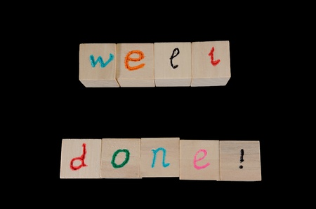 well done: Well done words on group of wooden cubes