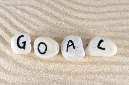 Goal word on group of stones on the sand photo