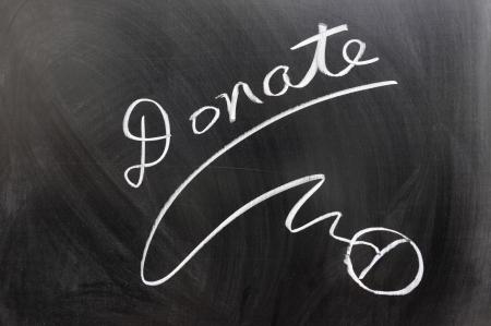 contribuire: Donate il mouse e segno scritto sulla lavagna Archivio Fotografico