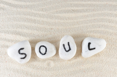 Soul word on group of stones with sand background Archivio Fotografico