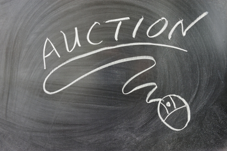 Auction word and mouse symbol on the chalkboard photo