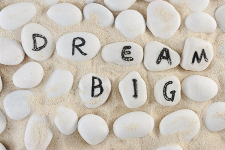 Dream big words among group of stones on the sand Archivio Fotografico