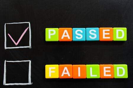 pass test: Passed or failed words made of blocks on blackboard