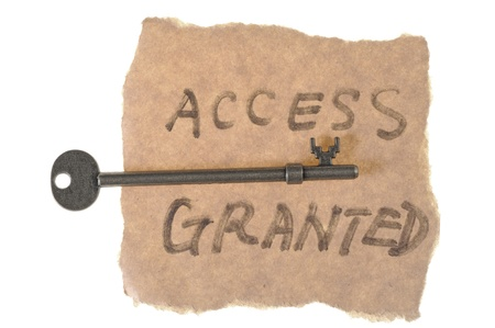 access granted: Old key and access granted words written on paper isolated on white Stock Photo