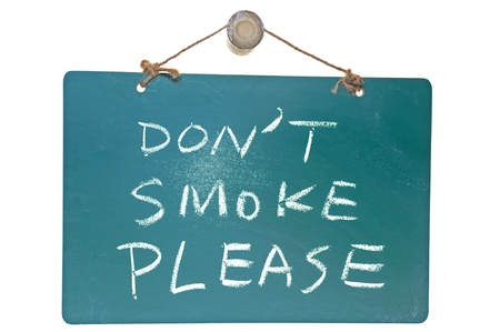 Don't smoke please words on green board isolated on white background photo