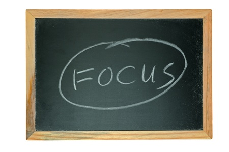 Focus word written on chalkboard isolated on white Stock Photo - 14635806