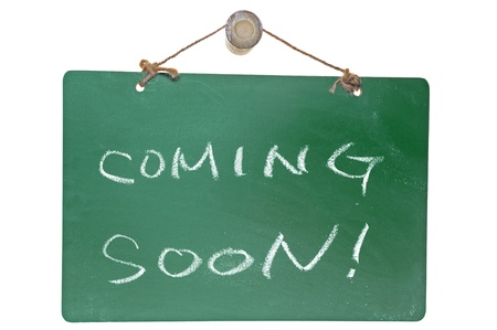 Coming soon words on green board isolated on white background