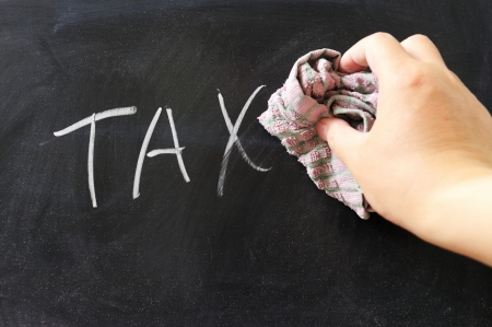 Hand wiping off tax word using rug Stock Photo - 15238831