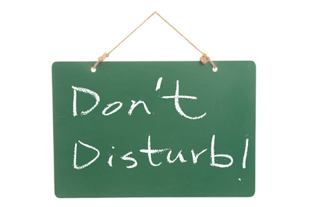 Don't disturb words written on green board Stock Photo - 15685274