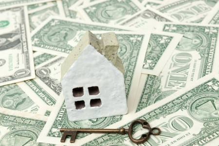 Key and house model isolated on white photo