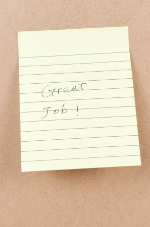 great job: Great job words written on a sticky note Stock Photo