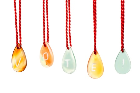 Vote word spelled with agates that are engraved with white letters and are hung by ropes, isolated against white background Stock Photo - 15836705
