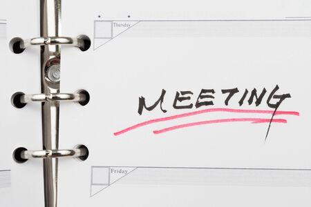 Meeting word written on notebook Stock Photo - 16025816