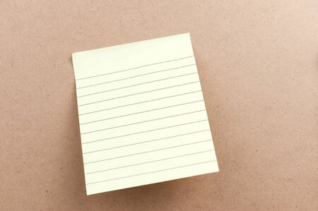 bulletinboard: Blank sticky note attached on the wooden board
