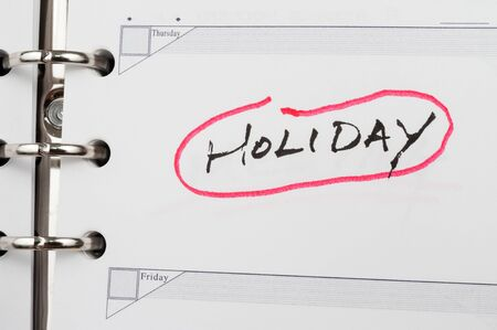 Holiday word written on notebook photo