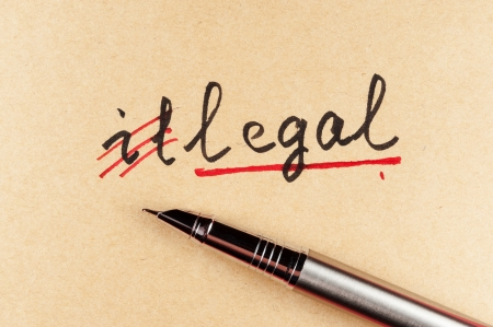 crime solving: amending Illegal word and changing it  to legal using a pen