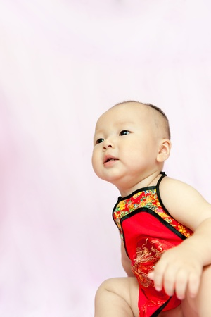 Asian baby wearing Chinese traditional style undergarment photo