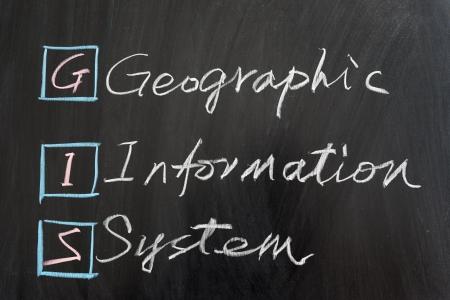 GIS 地理情報システム、黒板に書かれました。 写真素材