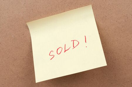 Sold word written on a sticky note Stock Photo - 16437357