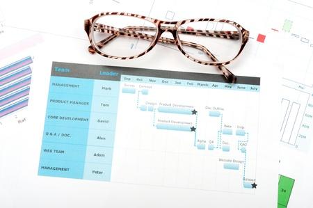 data sheet: Gantt diagram printed on white paper with glasses on it Stock Photo