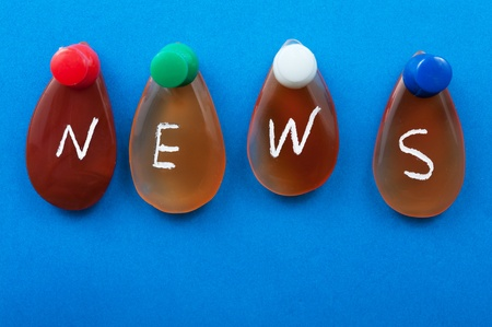 News word spelled with agates pinned on the board Stock Photo - 16813603