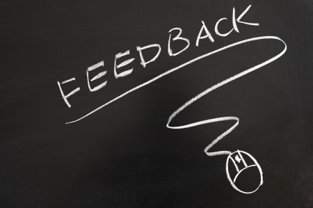online survey: Feedback word and mouse symbol drawn on the blackboard Stock Photo
