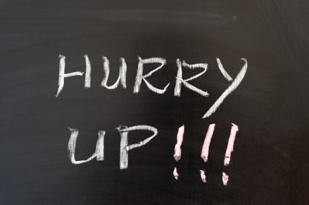 hurry up: Hurry up words written on the chalkboard Stock Photo