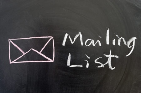 email lists: Mailing list words and symbol on the blackboard