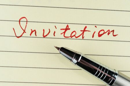 Invitation word written on lined paper with a pen on it Stock Photo - 17071964
