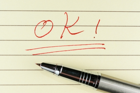 ok word written on lined paper with a pen on it Stock Photo - 17071959