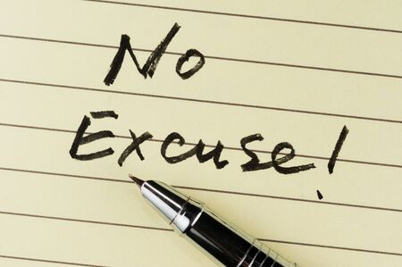 excuse: No excuse words written on lined paper with a pen on it