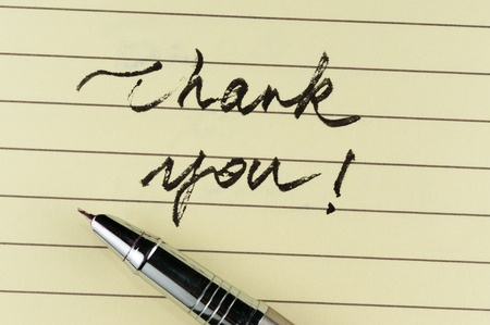 Thank you words written on lined paper with a pen on it Stock Photo - 17071986