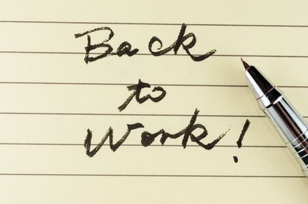 Back to work words written on lined paper with a pen on it Stock Photo - 17071961