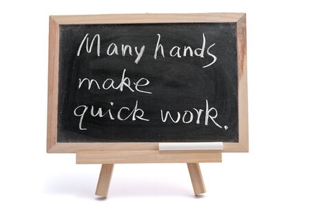 &quot,Many hands make quick work&quot, saying written on blackboard over white background Stock Photo - 17071952