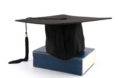 masters degree: Graduation cap on a thick book Stock Photo