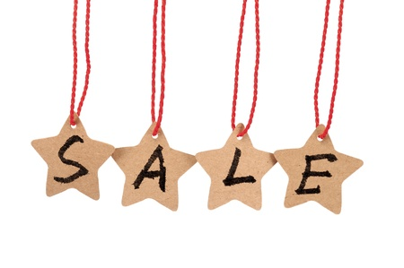 Sale spelled with paper stars  are hung by ropes, isolated against white background Stock Photo - 17385302