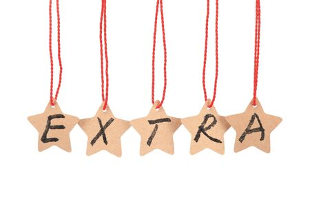 Extra spelled with paper stars  are hung by ropes, isolated against white background Stock Photo - 17385301