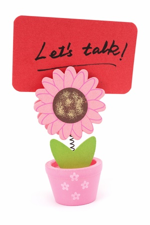 let on: Lets talk words written on red paper of sun flower pot clip