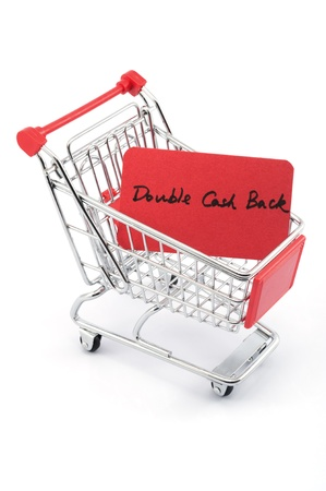 supermarket cash: Double cash back words written on red paper card in shopping cart on white background