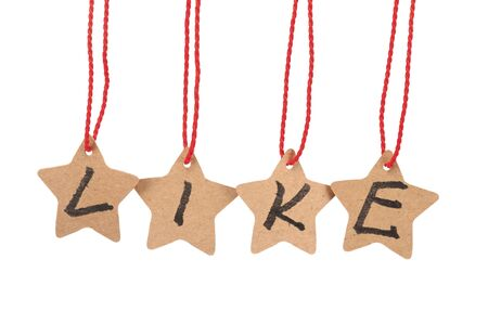 pointed: Like word spelled with paper stars  are hung by ropes, isolated against white background